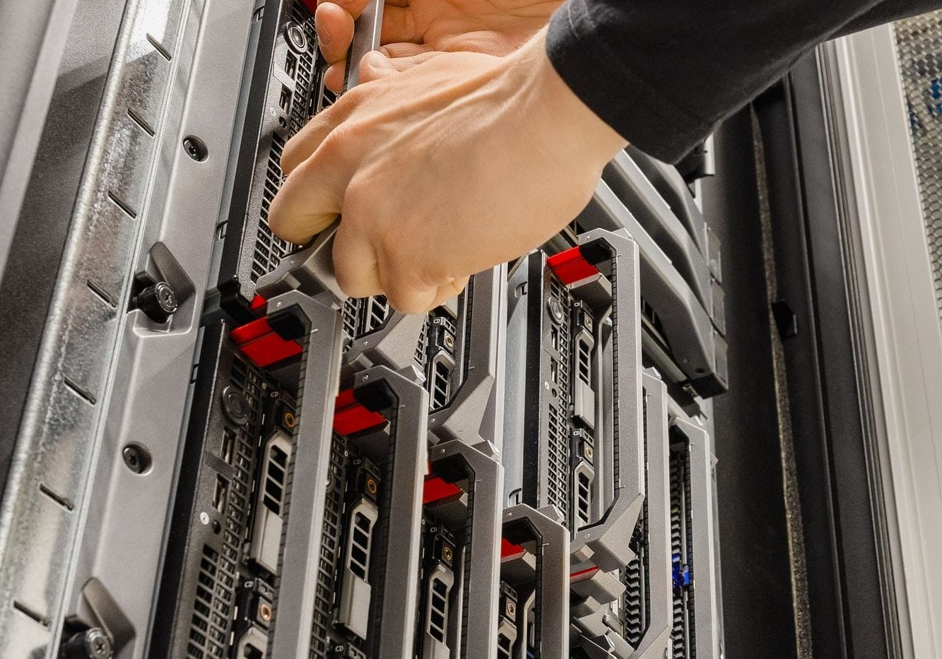 Male IT Consultant Removing Blade Server From Rack in Datacenter